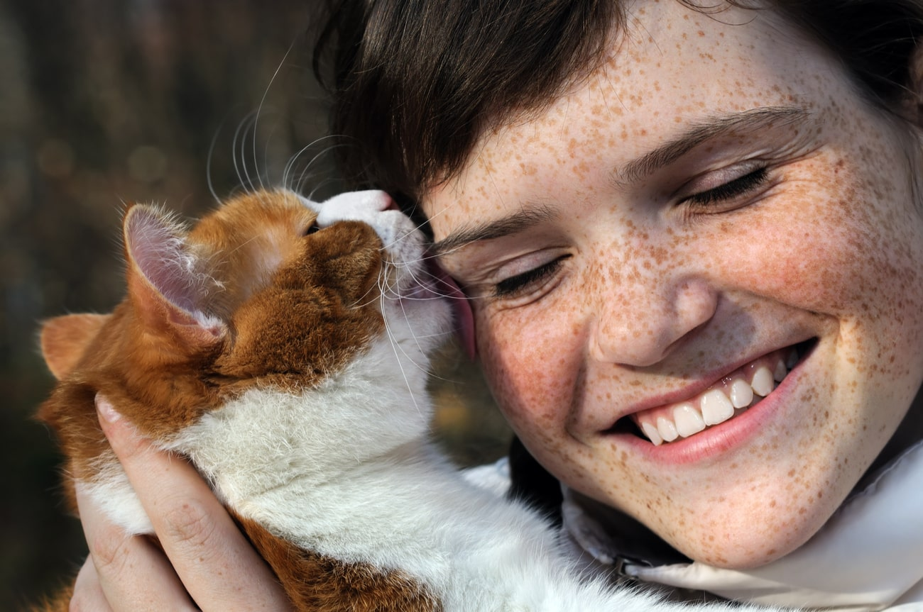 Cat licking a person